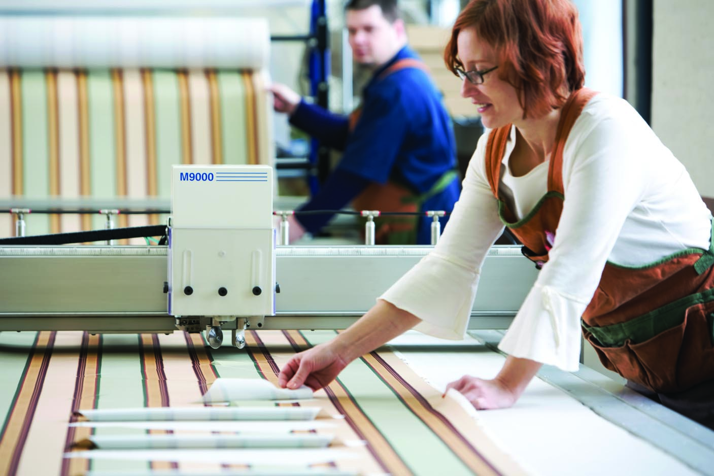 Worker making custom roller shades at manufacturer in rochester ny